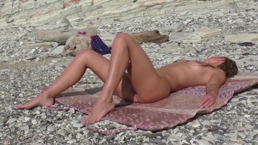 Travel blogger met a nudist girl. Public blowjob on the beach in Bulgaria.