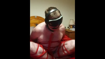 Bound and gagged cross-legged naked 2