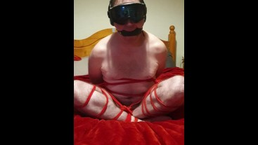 Bound and gagged cross-legged naked 4