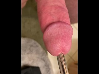 Virgin shoves a 15 inch metal rod down his cock