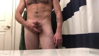 Showing off my tight ass and stroking till I cum