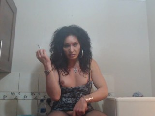 Mature trans sitting kitchen cock...