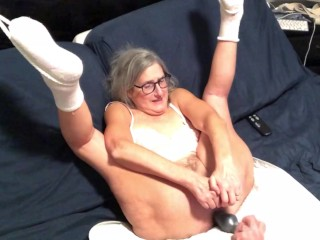 Enjoys toying her wet pussy takes in...