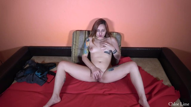 Tattooed girl masturbating on a couch 4