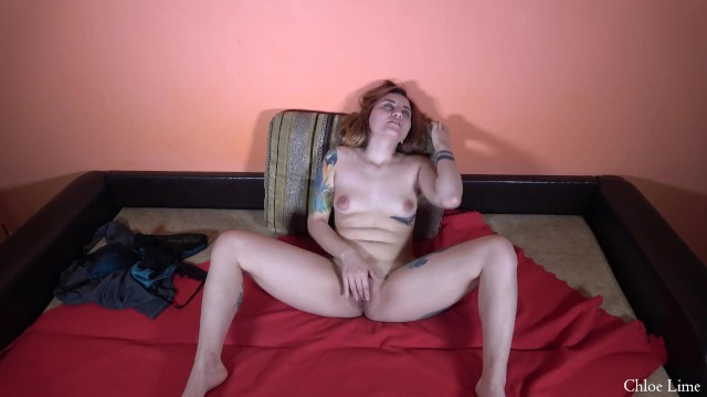 Tattooed girl masturbating on a couch 46
