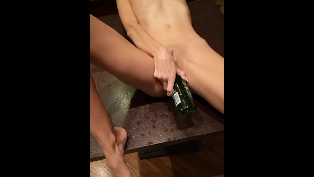 Bitch fucking a bottle Pissing on her while masturbating with a beer bottle
