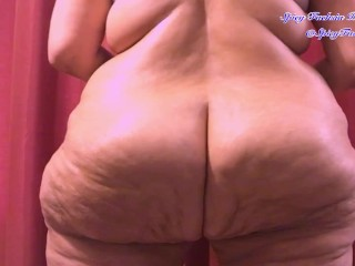 Clenching and jiggling big naked ass...