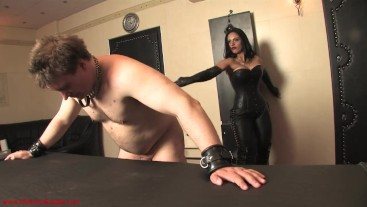 Whipped to despair: Mistress Ezada usig Her slave in the club