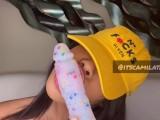 Camila Taylor looking pretty while sucking confetti dildo