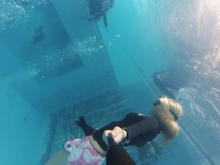 Sexy blonde snorkeling breath holding in swiming pool...