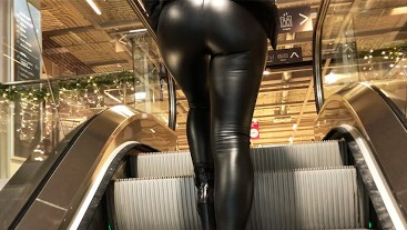Amateur girl with leather leggings searching for a perfect Christmas tree