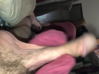 Adorable little feet stroking a huge cock with pink socks for footjob