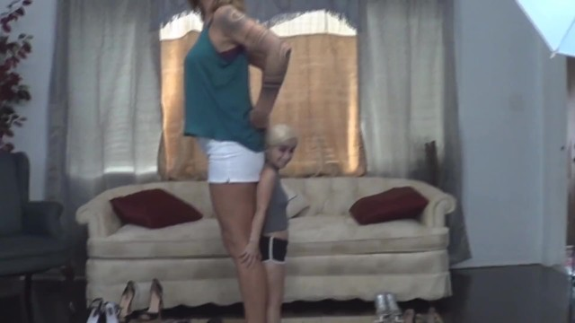 Tall amazon wrestles with midget Tall woman and midget