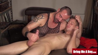 Young cock oiled up and sucked by horny masseur daddy