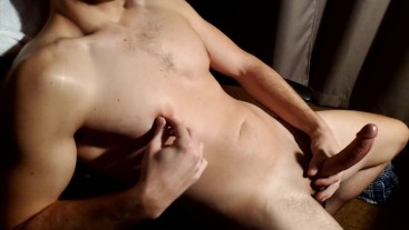muscle stud shooting a huge load. Playing with nips