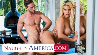 Screen Capture of Video Titled: Naughty America Bridgette B. works the plumber's pipe