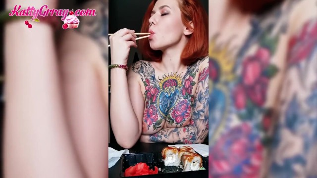 Naked at play Horny tattooed girl eats naked and plays with tits - solo
