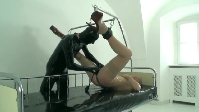 Girl fucked by dildo - Rubber girl fucked with dildo in transparent latex catsuit mask gloves