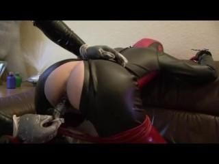 Rubber slave girl piss pants mouthgag latex sheet...