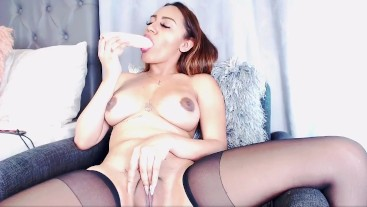 Very sexy girl gives a phallus blowjob and fingering at the same time