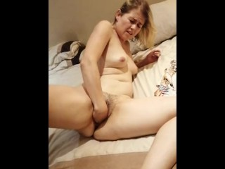 Sexy lizzy fisting and masturbating her naked pussy...