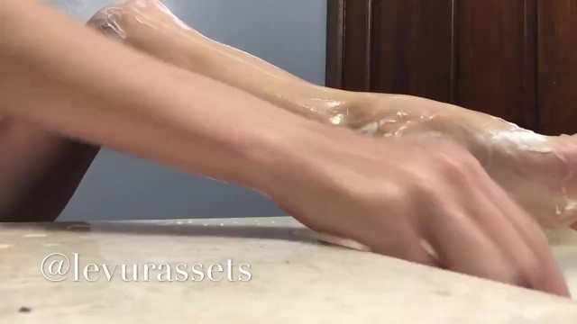 Flexible naked Redhead shaves legs. Glimpses of her red bush. 15