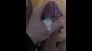 Guy jerking off his thick cock watching porn with a massive cumshot