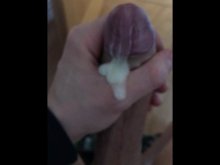 Guy jerking off his thick cock with cumshot...