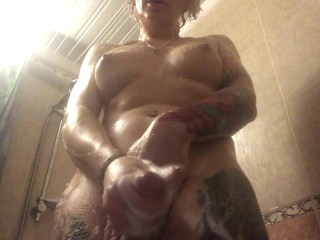 Shemale takes shower and shave her girly dick...