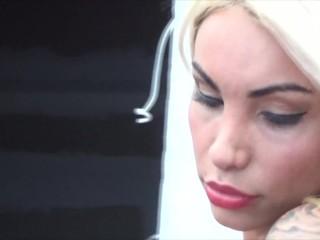 Modeling white lingerie and heels Angeles Cid gets her huge cock out.