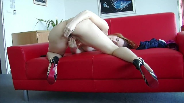 Girl on the red couch solo with glass dildo 6