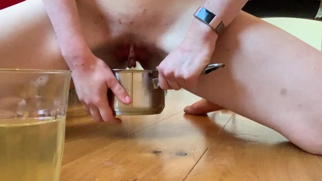 Pissing escorts Escort emma fills up two cups with piss and keeps going