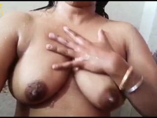 Desi bhabhi taking shower showing big boobs wet pussy
