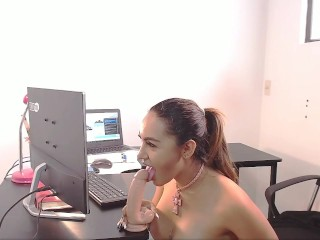 Recording on camera while working with a large rubber dick