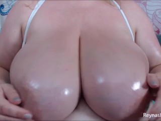 Huge all natural titties oiled up