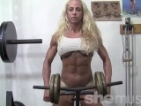 Blonde muscle babe works out her insane body in the gym