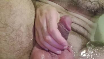 Teen boy pisses on himself and jerks off his big cock.