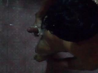 Asian guy take a bath off in bathroom...