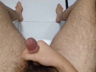 Cute boy moaning while wanking in the toilet