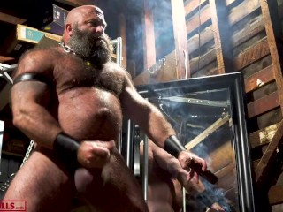 Muscle smoking cigar and stroking his fat hog...