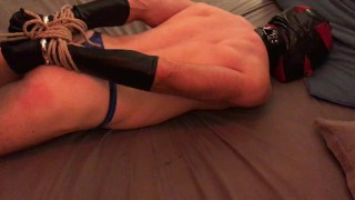 Slave gagged with duct tape, whipped and hogtied