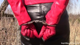 Wife in black-red leather on walk with handcuffs (SAMPLE)