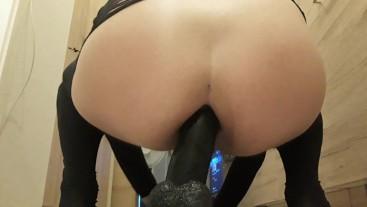 Cute ass rides big black dildo