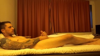 German Tattood Soldier jerks Off in Hotel and cums fast and hard.