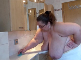 Topless bathroom cleaning...