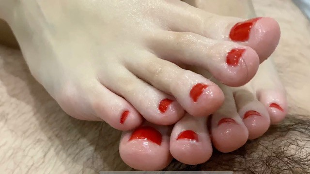 Red head footjob Footjob with oil for brother. cum on feet with red nails.