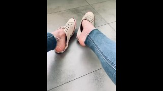 Alicia's feet play with her converse and wearing an tight jean