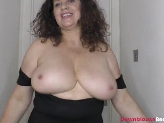 Brunette mature Gilly showing tits and oiling them up nicely