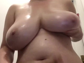 Fucking my huge boobs with a dildo