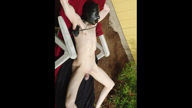 Gay collared slaves Restrained rubber gimp slave, sunbathing